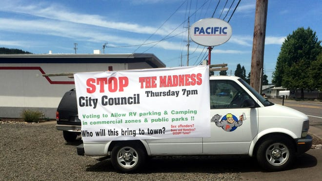 Pacific Sign owner DJ Thommen said he created this sign and others to get Turner residents to attend a council meeting where revising a city ordinance about camping would be debated.