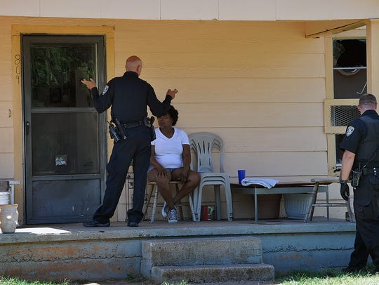 Wichita Falls Police speak with a woman at a residence