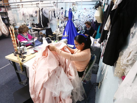 From left, seamstresses Giulia Belmonte, Ninfa Mora
