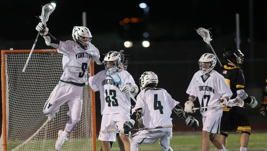 From left, Yorktown's Jamison Embury (3) Alex Debenedictis