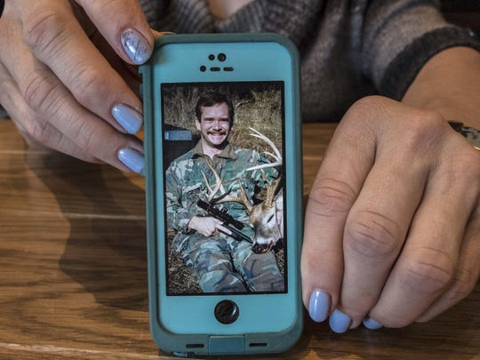 Robin Patty, a former Green Beret, shows a picture that she keeps on her phone of a deer she shot when she was in the military.