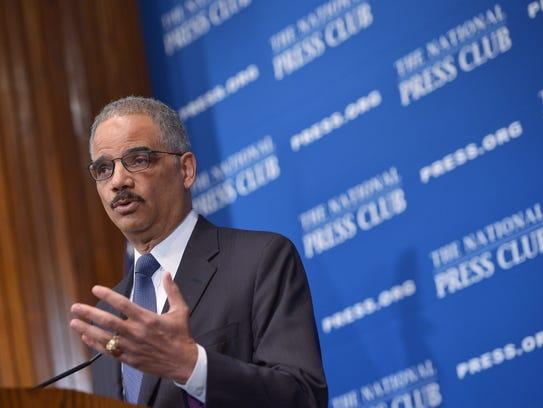 U.S. Attorney General Eric Holder speaks on criminal