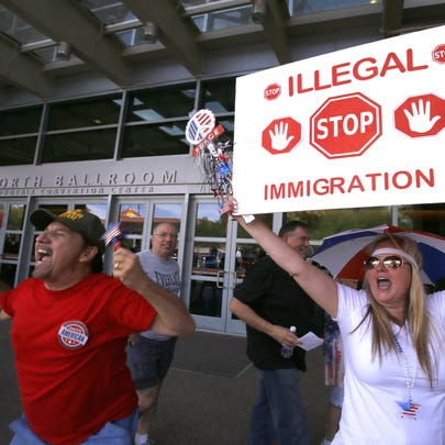 Supporters taunt protesters outside the Phoenix Convention