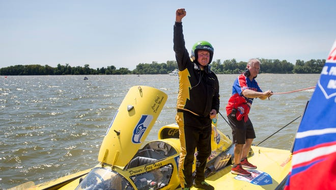 Greg Hopp raises his fist after winning his heat of the HydroFest at the Evansville riverfront in Evansville, Ind., on Saturday, Sept. 2, 2017. Hopp races a Grand Prix Hydroplane. Hopp's father, Jerry, will also be racing, and the two will compete against each other.