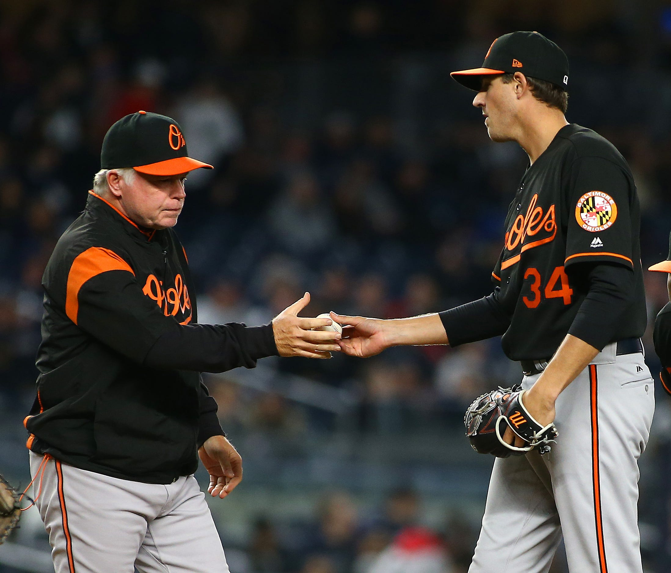 Orioles manager Buck Showalter takes the ball from starting pitcher Kevin Gausman.