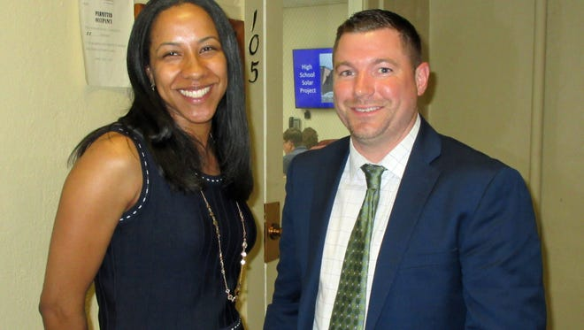 Crystal Marsh (left), newly named assistant principal of Edison Intermediate School in Westfield, is congratulated by Dr. Matt Bolton, the school's principal, following the Board of Education's unanimous approval of Marsh's appointment.