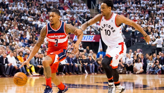 Washington Wizards guard Bradley Beal (3) controls the ball as Toronto Raptors guard DeMar DeRozan (10) defends in the second quarter during game five of the first round of the 2018 NBA Playoffs at Air Canada Centre.