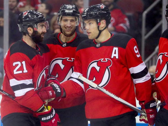 Mar 31, 2018; Newark, NJ, USA; The New Jersey Devils celebrate a goal by left wing Taylor Hall (9) during the second period against the New York Islanders at Prudential Center.