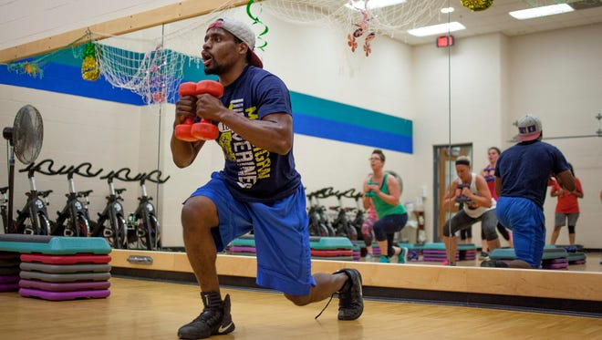 Tim Browning leads a work out during a high-intensity interval training class Wednesday, June 28, 2017 at the YMCA of the Blue Water Area.