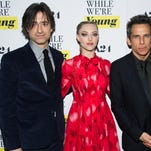"Director Noah Baumbach, left, Amanda Seyfried and Ben Stiller attend the premiere of ""While We're Young"" on March 23 at the Paris Theatre in New York."