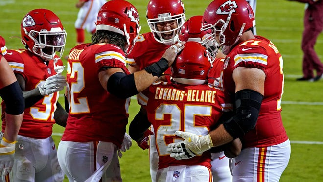 Kansas City Chiefs running back Clyde Edwards-Helaire (25) celebrated a touchdown with his offensive linemen during last week's opener against Houston. Line play was a key in the Chiefs' victory.