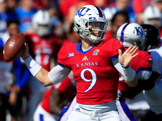 Kansas quarterback Carter Stanley passes to a teammate during the first half of an NCAA college football game against Texas Tech in Lawrence, Kan., Saturday, Oct. 7, 2017. (AP Photo/Orlin Wagner)