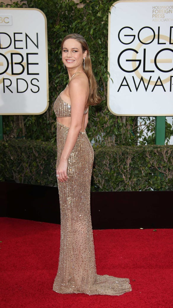 Brie Larson stunned in a gold Calvin Klein dress with