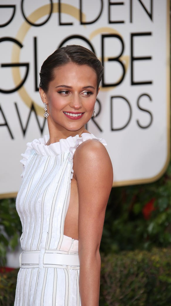 Alicia Vikander arrives at the 73rd Golden Globe Awards.