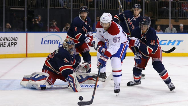 Montreal Canadiens left wing Max Pacioretty tries to control the puck in front of New York Rangers goalie Henrik Lundqvist during the first period at Madison Square Garden.