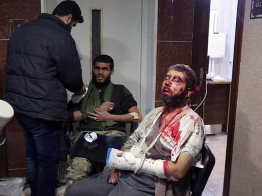 This image released by Aleppo Today TV, shows two men