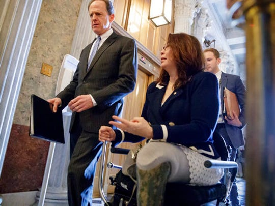 Sen. Pat Toomey, R-Pa., left, and Sen. Tammy Duckworth,
