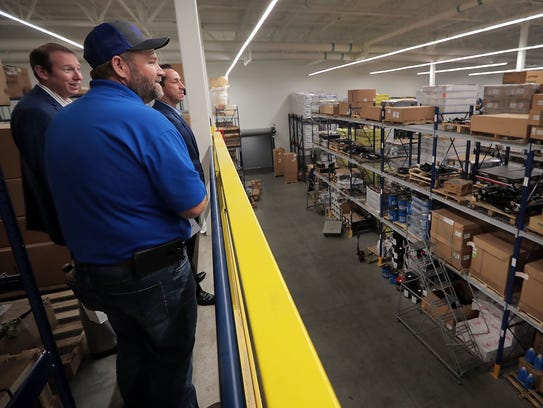 Warehouse Manager Pete Burns leads visitors through