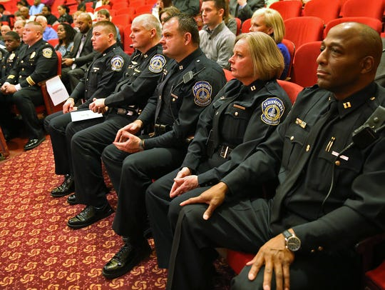 IMPD officers to be promoted listened to speakers during