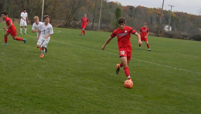 Mason junior Lirim Shefkiu gains control of the ball during Saturday's Division 2 district final against Chelsea.