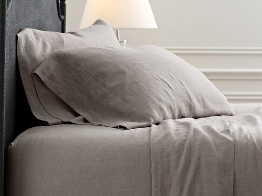 Restoration Hardware's Stonewashed Belgian Linen sheets ($269) in white. With an extra set of pillowcases in Fog.