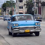 U.S. cars from the 1950s still ply Cuban streets. Private car ownership has been limited in Cuba since the 1959 revolution, and the 1962 U.S. embargo dried up repair parts, but mechanics still keep the old models running. This 2011 photo shows a 1958 Oldsmobile in use in Havana as a taxi.