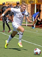 Midwestern State's Alex Mullet chases the ball as it goes out of bounds Saturday, Oct. 7, 2017, in the match against UT Permian Basin at Stang Park.
