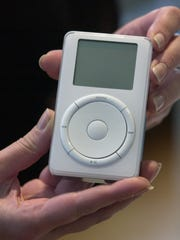 The original iPod is displayed after its introduction by Apple Computer Inc. chief executive officer Steve Jobs during a news conference in Cupertino, Calif. on Oct. 23, 2001.
