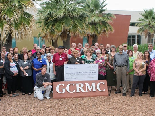 Thrive in Southern New Mexico along with Gerald Champion Regional Medical Center employees stand with a check of $170,000 that GCRMC donated to the non-profit for its 2017-2018 campaign.
