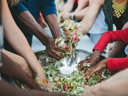 Many hands make light work of breaking down vegetables