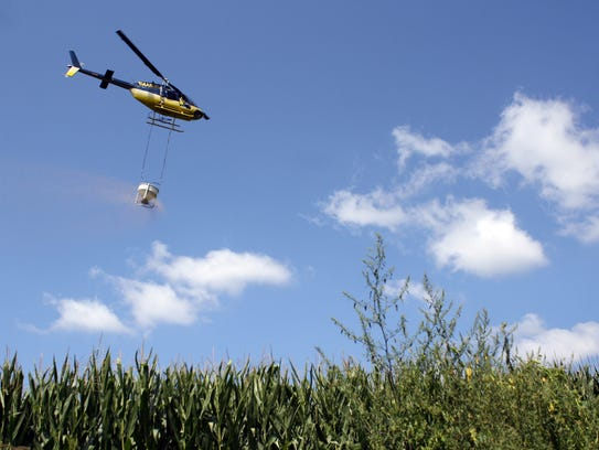 The aerial cover crop conservation practice involves