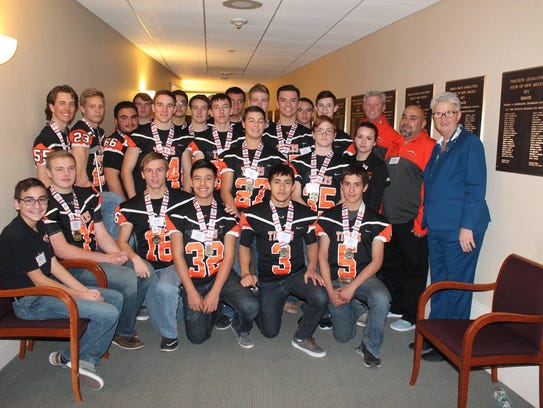 The Capitan High School football team with New Mexico