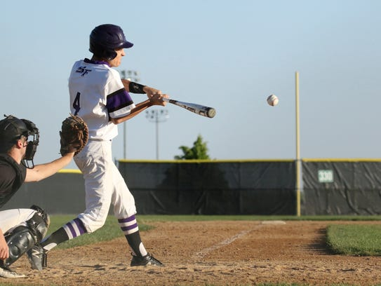 Elliot Barnes of Post 15 East connects on a pitch during