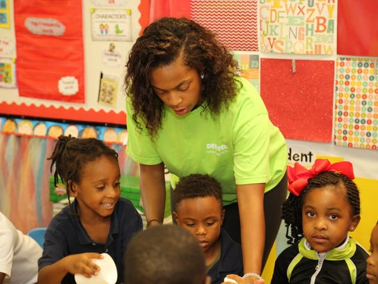 A Faulkner University student mentors children at Davis