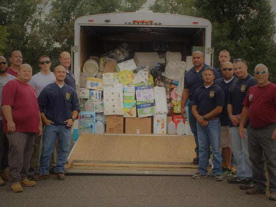Monroe Police, DPW and EMS loaded up five pickups and