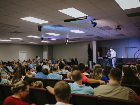 Pastor Joel Gatlin preaches to the congregation at