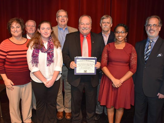 "Certificate of achievement went to Douglas Miles and the James M. Bennett High Clipper Band for its season's best score of 91.7 and ninth place, Silver Medal Finalist in Group 3-Open competition at the Tournament of Bands Atlantic Coast Championships on Oct. 29 at Hersheypark Stadium in Hershey. The James M. Bennett High School Marching Band presented the field show ""The Hope of Spring"" in 2017."