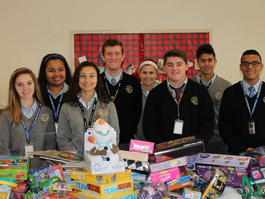 Immaculata High School volunteers for SHIP's gift bagging