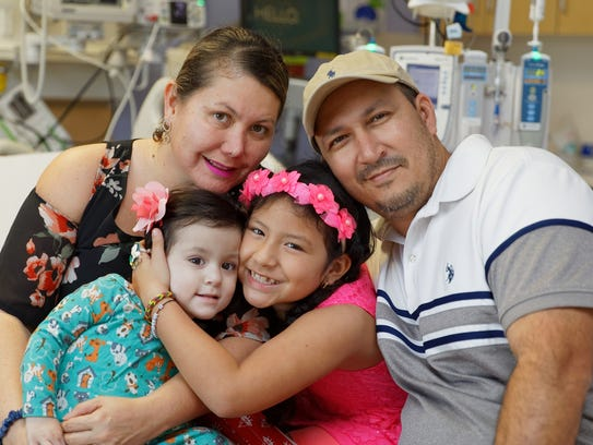 Isabella Soto, 1, of Naples and her family at Johns