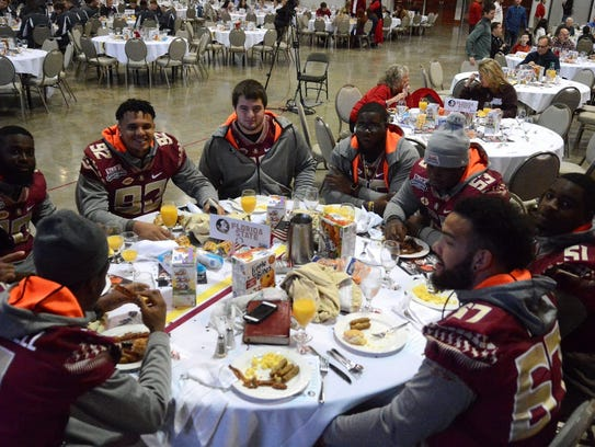 Florida State players enjoying breakfast during the
