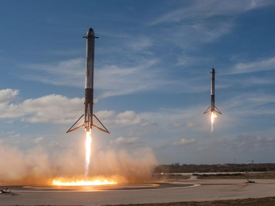 The two side boosters from the first stage of SpaceX's