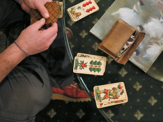 A collector displays items for evaluation at last year's
