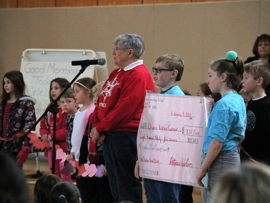 Aiden Payne addresses students at the Dryden Has Heart
