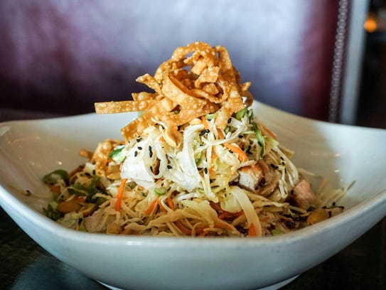 The ginger chopped chicken salad with cabbage, carrots,