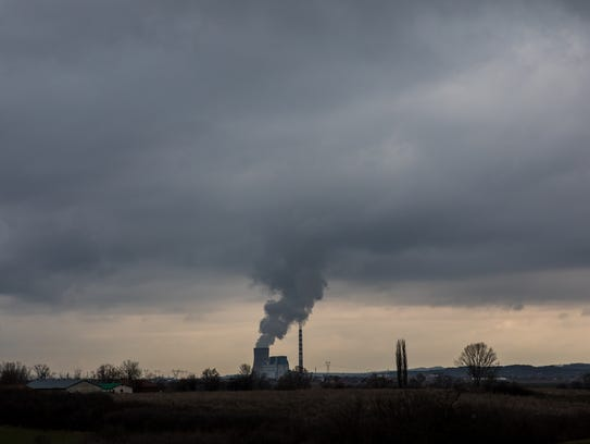 Smoke spews from one of Kosovo's two coal-fired power