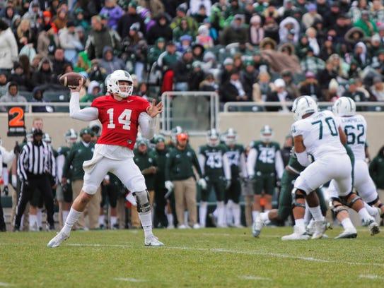 Michigan State QB Brian Lewerke readies to throw the