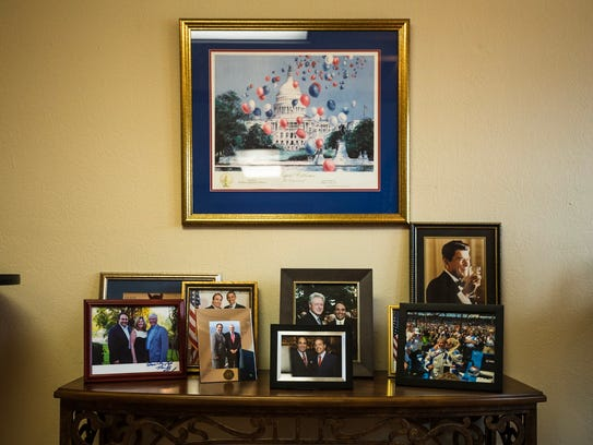 Framed photos of past presidents and iconic figures