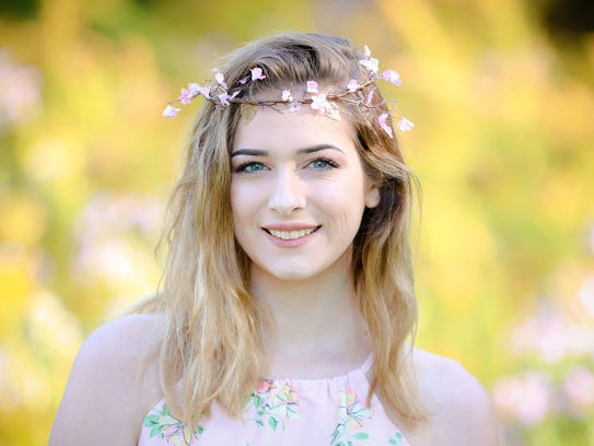 Madison Kidney, 17, of Freeville, was suspended Wednesday