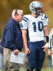 Brian Walsh, left, then the John Jay High School football coach, talks with quarterback Nick Strang during an Oct. 18, 2008 win over Roy C. Ketcham.