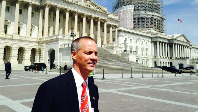 Rep. Curt Clawson, R-Fla., stands outside the U.S. Capitol in Washington. Clawson is leaving Congress but his seat is not considered competitive this fall.